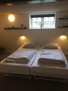 En eller flere senge i et værelse på BB-Vesterskov
