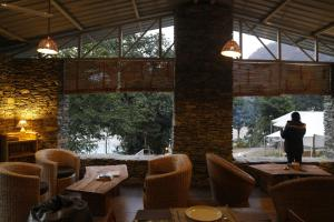 A restaurant or other place to eat at Banyan By The Ganges