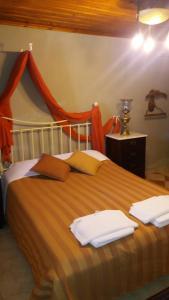 Ένα ή περισσότερα κρεβάτια σε δωμάτιο στο Αρχοντικό Πάντου