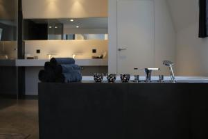 A kitchen or kitchenette at B&B For 2-Wellness For 2