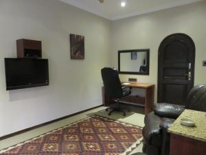 A television and/or entertainment center at Tladi Lodge