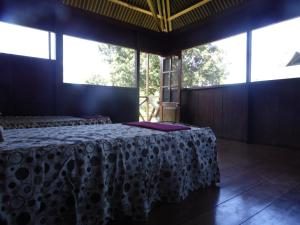 A bed or beds in a room at Aguajal Manu Lodge