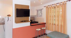 A television and/or entertainment centre at Ancoradouro Flats