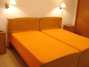 A bed or beds in a room at Rialgarve