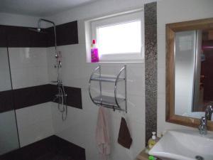 A bathroom at Apartments Dobrinj