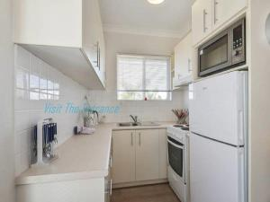 A kitchen or kitchenette at Surf Side Palms 12