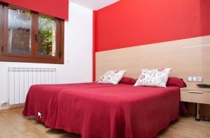 Cama o camas de una habitación en Apartahotel Castejón de Sos