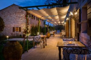 A restaurant or other place to eat at Meneghetti Wine Hotel and Winery - Relais & Chateaux