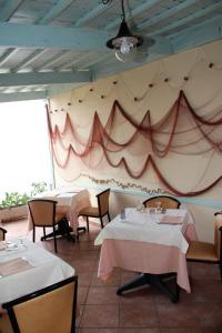 A restaurant or other place to eat at Geranio Rosso Hotel & Restaurant