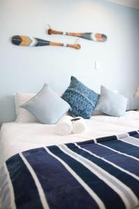 A bed or beds in a room at Sea Wind Self Catering Cottages