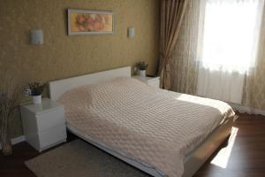 Postel nebo postele na pokoji v ubytování Jurincom apartments