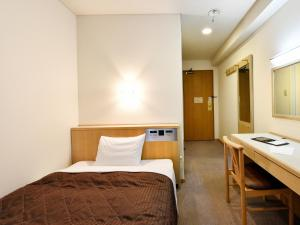 A bed or beds in a room at Hotel Pearl City Sapporo