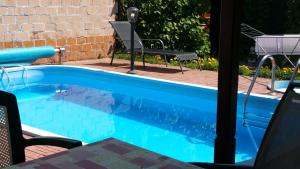 The swimming pool at or near Pension Tip-Top