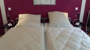 Ein Bett oder Betten in einem Zimmer der Unterkunft Villa 46 Flensburg