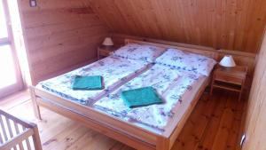 A bed or beds in a room at Drevenica pod Troma Korunami