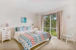 A bed or beds in a room at GDay Beach House