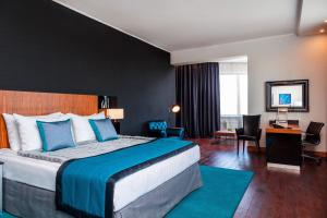 A bed or beds in a room at Radisson Blu Chelyabinsk Hotel