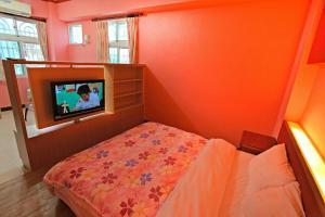 蕃茄咖啡民宿房間的床