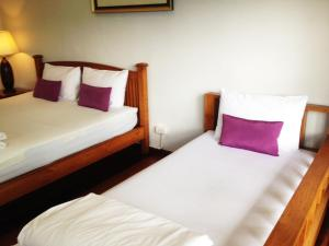 A bed or beds in a room at Baan Pai Nai Wieng