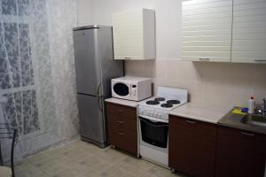 "A kitchen or kitchenette at ""Comfort Russia"" на Партизанской"