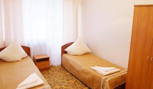 Кровать или кровати в номере Санаторий Камские Зори