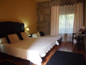 Uma cama ou camas num quarto em Casa das Magnólias de Igarei