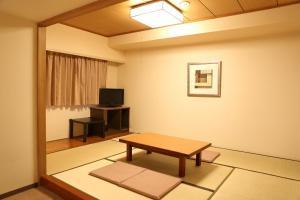 A television and/or entertainment center at Sun Hotel Nagoya Nishiki