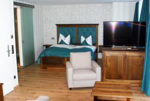Ein Bett oder Betten in einem Zimmer der Unterkunft Rüter's Hotel & Restaurant