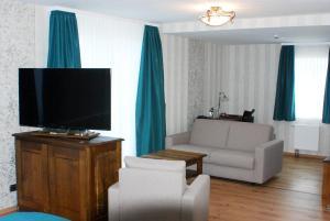 TV/Unterhaltungsangebot in der Unterkunft Rüter's Hotel & Restaurant