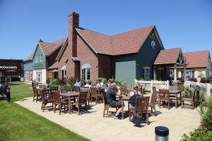A restaurant or other place to eat at Blue Jay, Derby by Marston's Inns