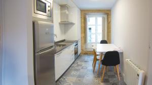 Una cocina o zona de cocina en Abastos SCQ by Como en Casa