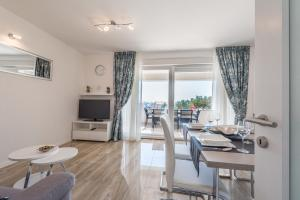 A seating area at Apartments with pool Villa Zora