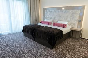 A bed or beds in a room at Le Chateau Des Thermes