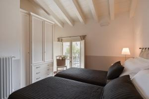 A bed or beds in a room at Appartamenti Palazzo Scolari
