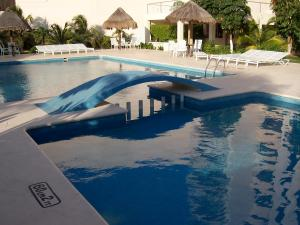 The swimming pool at or near Salvia Cancun Aparts
