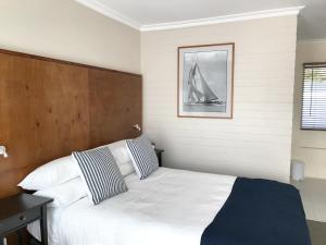 A bed or beds in a room at The Waterfront Wynyard