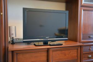 Телевизор и/или развлекательный центр в Апартаменты в районе Светлана