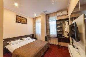 A bed or beds in a room at Biy Ordo Hotel & Hostel