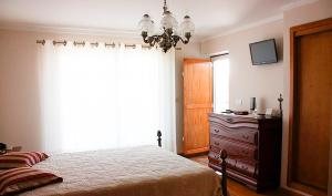 A bed or beds in a room at Casa de Campo S. Torcato - Moradal - Turismo Espaco Rural