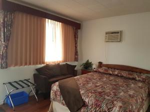 Cama o camas de una habitación en Flamingo Motel