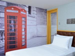 Säng eller sängar i ett rum på Kew Green Hotel Wanchai Hong Kong