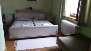 A bed or beds in a room at Penzion Dora