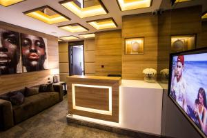 The lobby or reception area at Eden Luxury Suites Terazije