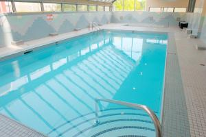 The swimming pool at or near Sandman Hotel Vancouver City Centre