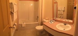 A bathroom at Western Budget Motel #3 Whitecourt