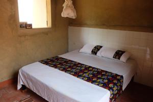 Cama o camas de una habitación en Centre Touristique et Culturel Casamance
