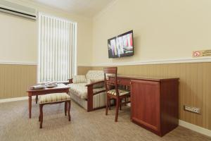 A television and/or entertainment center at Consul Hotel