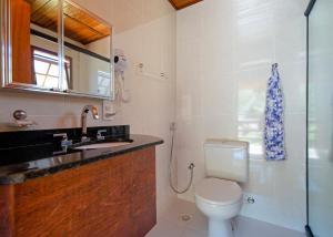 Um banheiro em Pousada Nó da Madeira