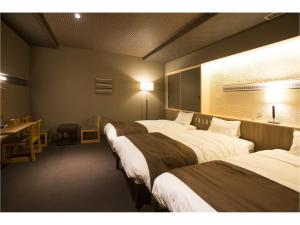 A bed or beds in a room at Wakkanai Grand Hotel