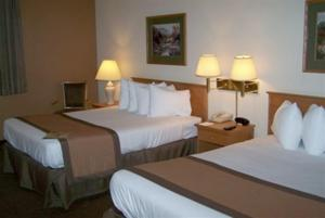 A bed or beds in a room at Ramada by Wyndham Waupaca